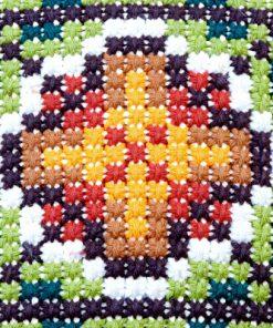Broderad kudde – Korsstygn grafiskt dekorativ blomma