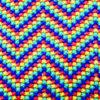 Broderad kudde – Korsstygn zig zag-mönster i regnbågsfärger detalj