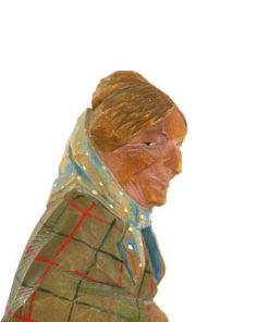 C O Trygg signerad tragumma och traskulptur profil