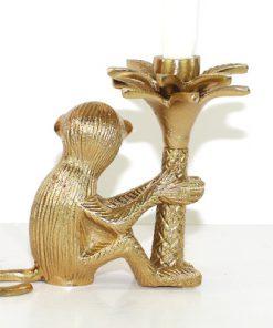 Apa som haller i en palm - Massings-figurin och ljusstake baksida