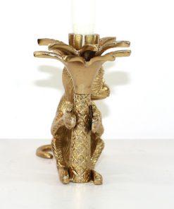 Apa som haller i en palm - Massings-figurin och ljusstake fram