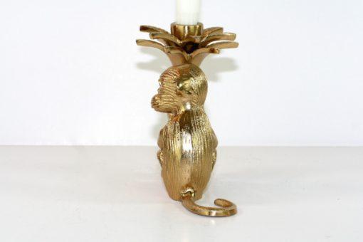 Apa som haller i en palm - Massings-figurin och ljusstake rygg