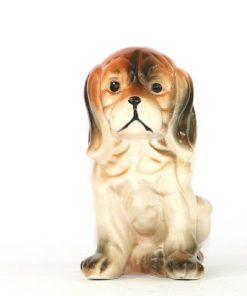 Bilden visar en figurin, hund Hamilton-stövare framsida