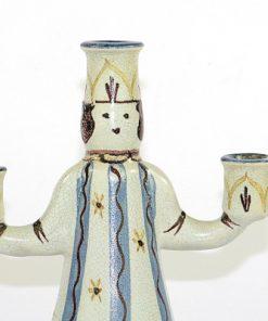 Bilden visar Bo Fajans Figurin ljusstake Lucia - Signerad Yozo B. närbild