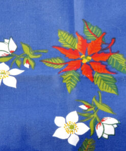 Bilden visar Retroduk – Julduk blå med julstjärnor och julrosor detalj fram